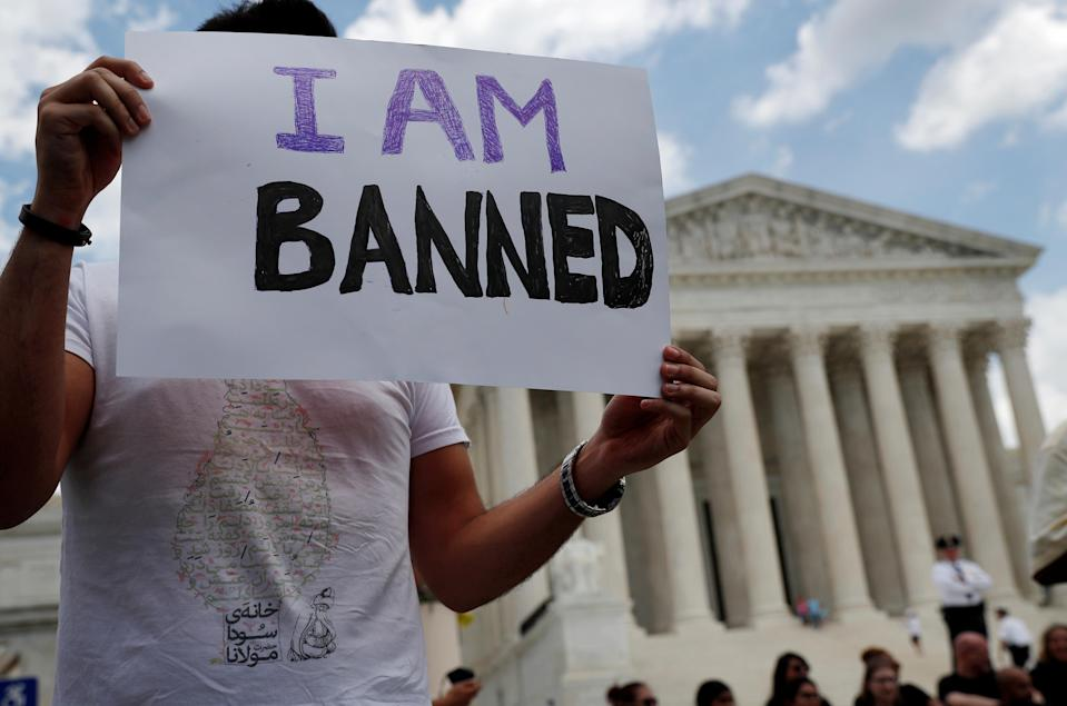 <p>Mehrad Ansari of Iran holds a sign outside of the U.S. Supreme Court after President Trump's travel ban was upheld in Washington, June 26, 2018. Ansari and his sister both attend university in the U.S. and now may not go home to see their family in Iran if they want to be able to return to the U.S. (Photo: Leah Millis/Reuters) </p>