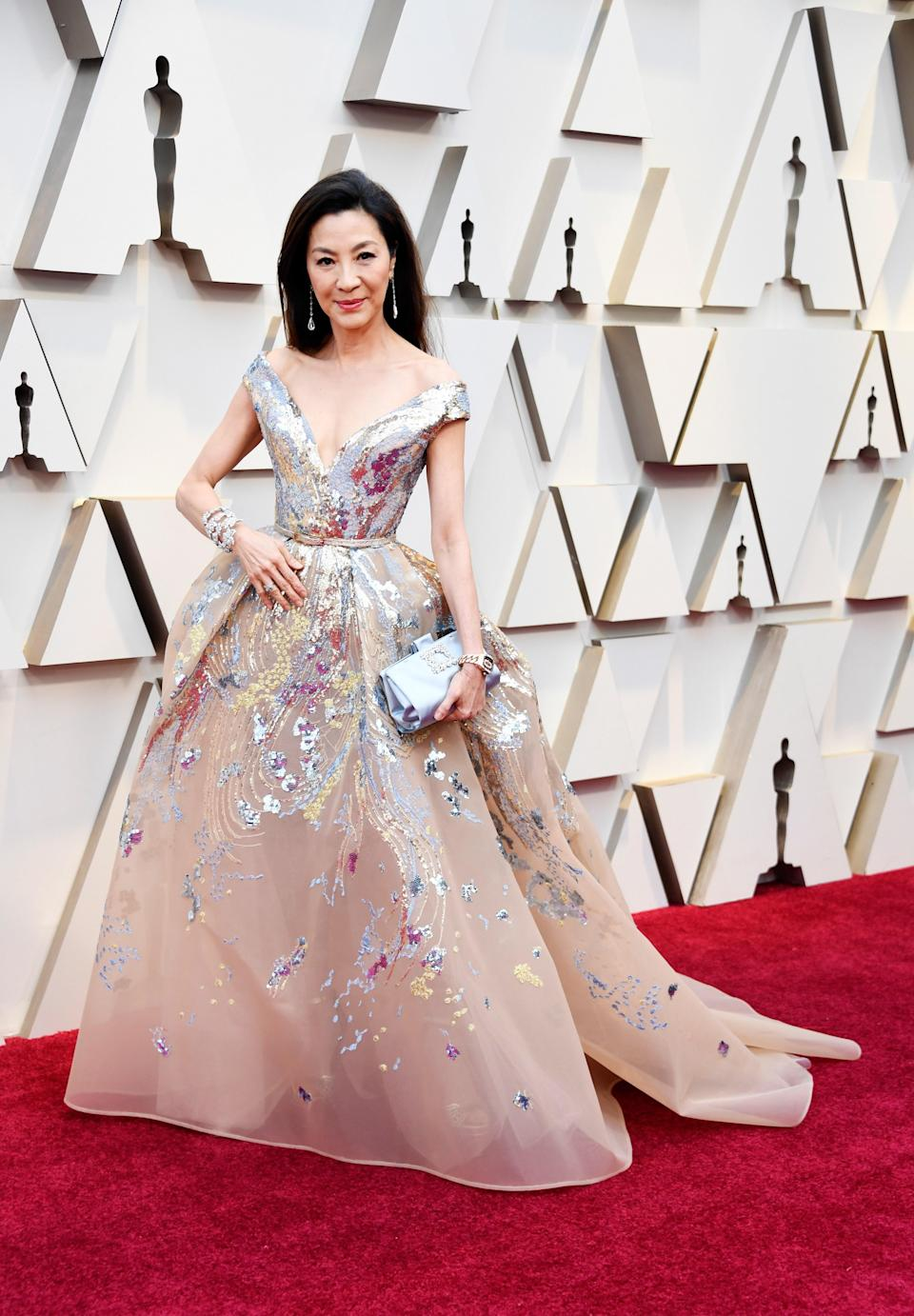 Michelle Yeoh in Elie Saab and Chopard jewelry with a Roger Vivier bag