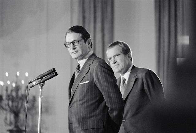 "<span class=""s1"">President Richard Nixon stands behind his new attorney general, Elliot Richardson, during Richardson's oath of office ceremony in May 1973. (Photo: Bettmann/Getty Images)</span>"