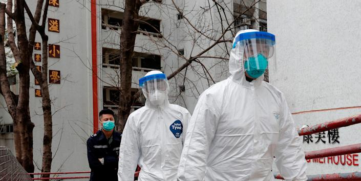 Health workers in protective gear at Cheung Hong Estate in Hong Kong in February 2020.