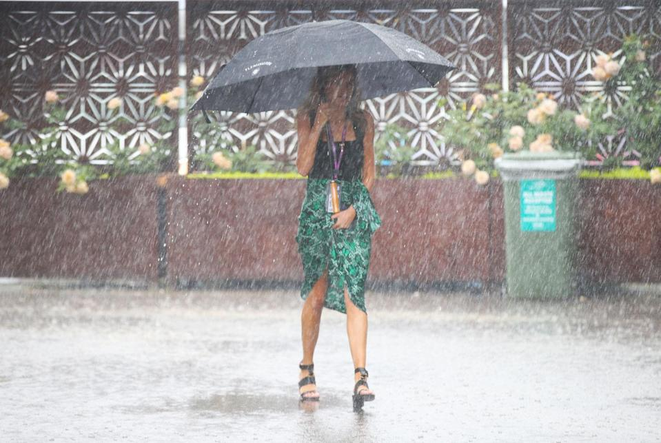 Rain and flash-flooding have hit Flemington just hours before the Melbourne Cup race. Photo: AAP
