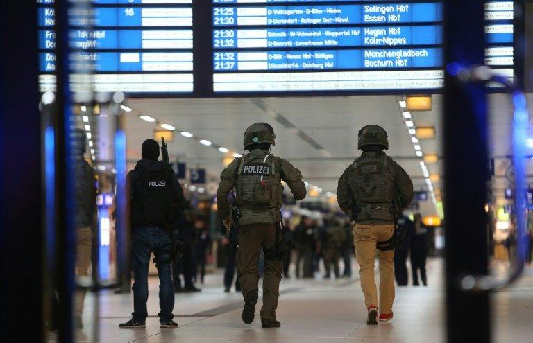 Special police commandos arrive at the main train station in Duesseldorf, western Germany after at least five people where injured by a man with an axe, on March 9, 2017, police said