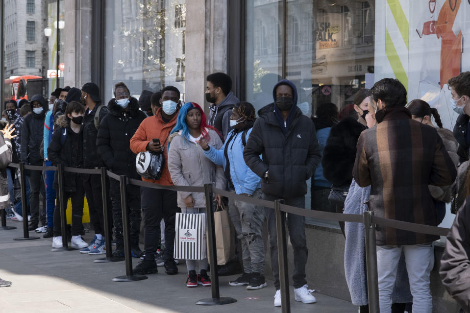 Shoppers queue to enter Nike Town on Oxford Street as non-essential shops reopen and the national coronavirus lockdown three eases on 12th April 2021 in London, United Kingdom. Now that the roadmap for coming out of the national lockdown has been laid out, this is the first phase of the easing of restrictions, and large numbers of people are out in London's retail district to go shopping. (photo by Mike Kemp/In Pictures via Getty Images)