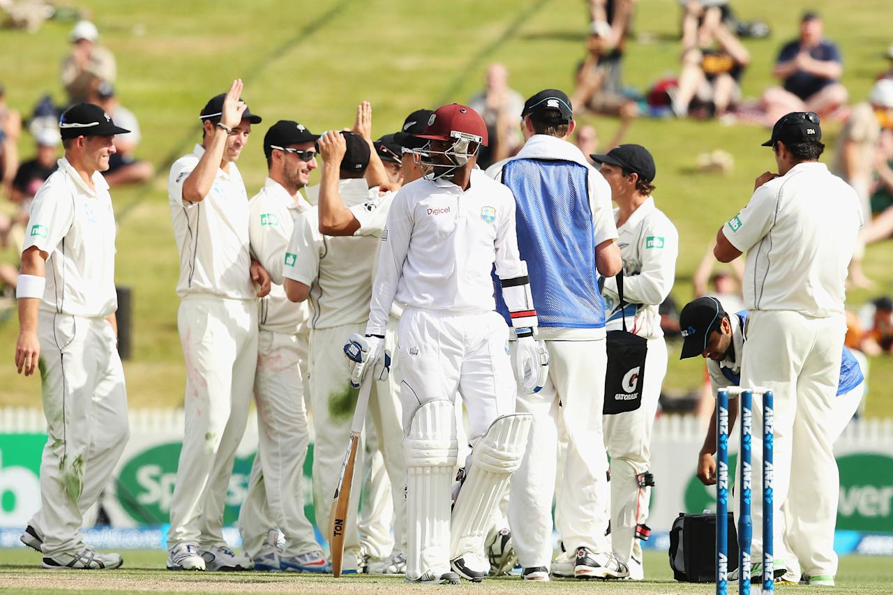 HAMILTON, NEW ZEALAND - DECEMBER 21:  Trent Boult of New Zealand celebrates after claiming the wicket of Denesh Ramdin of the West Indies during day three of the Third Test match between New Zealand and the West Indies at Seddon Park on December 21, 2013 in Hamilton, New Zealand.  (Photo by Hannah Johnston/Getty Images)