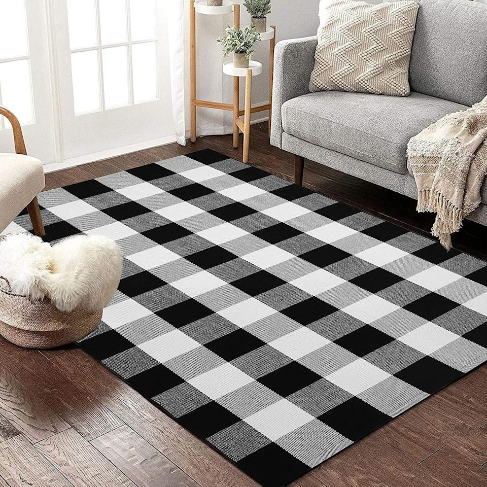 <p>This <span>Buffalo Plaid Rug </span> ($39) would look good in an office or guest room.</p>