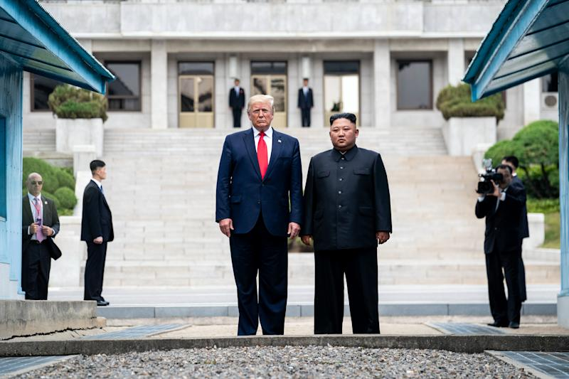 President Donald Trump and Kim Jong Un, the North Korean leader, prepare to cross from the North Korean side of the Demilitarized Zone into South Korea at Panmunjom on June 30, 2019. (Erin Schaff/The New York Times)