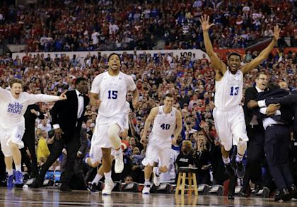 Duke players celebrate after the NCAA Final Four college basketball tournament championship game. (AP)