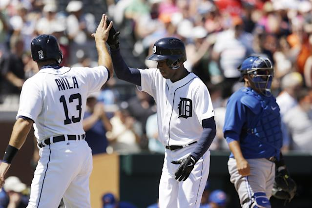 Detroit Tigers' Austin Jackson, right, is congratulated by teammate Alex Avila after his two-run home run during the second inning of a spring exhibition baseball game against the Toronto Blue Jays in Lakeland, Fla., Tuesday, March 18, 2014. (AP Photo/Carlos Osorio)