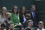 Britain's Kate, Duchess of Cambridge, top second right, sits with Tim Henman on Court 14 to watch the men's doubles match between Britain's Jamie Murray and Brazil's Bruno Soares against Nicholas Monroe of the US and Canada's Vasek Pospisil on day five of the Wimbledon Tennis Championships in London, Friday July 2, 2021. (Neil Hall/Pool via AP)
