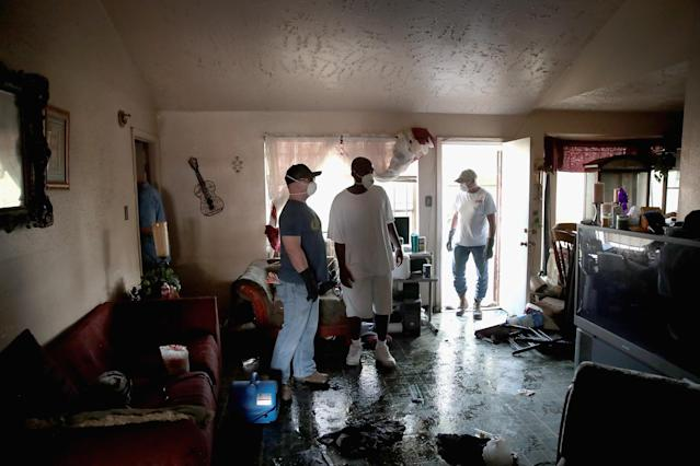 <p>People begin the process of cleaning up the damage to their property after torrential rains caused widespread flooding during Hurricane and Tropical Storm Harvey on September 1, 2017 in Houston, Texas. Harvey, which made landfall north of Corpus Christi on August 25, dumped around 50 inches of rain in and around areas of Houston and Southeast Texas. (Photo: Scott Olson/Getty Images) </p>
