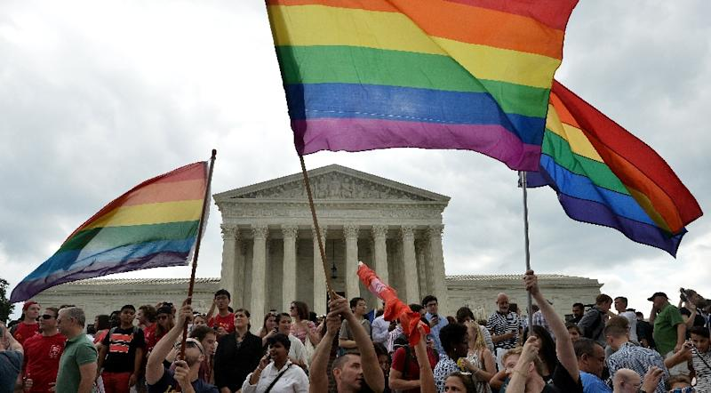 People celebrate outside the Supreme Court in Washington, DC on June 26, 2015 after its historic decision on gay marriage (AFP Photo/Mladen Antonov)