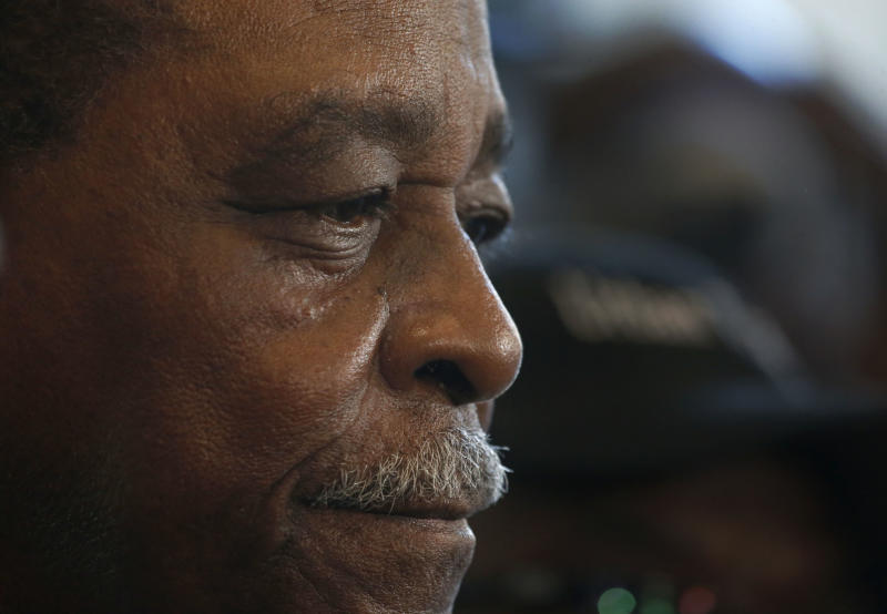 Cook County Commissioner William Beavers listens to a reporter's question at the federal building in Chicago, Thursday, March 21, 2013, after he was convicted of tax evasion for not declaring campaign cash he gambled away on slot machines as income. Beavers, whose commissioner's salary is $85,000, lost $500,000 over three years at Indiana's Horseshoe Casino, sometimes writing himself one $2,000 campaign check after another on daylong gambling binges. (AP Photo/Charles Rex Arbogast)