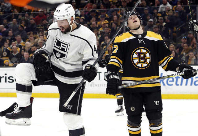 Los Angeles Kings' Nate Thompson, left, celebrates his goal next to Boston Bruins defenseman Torey Krug during the third period of an NHL hockey game Saturday, Feb. 9, 2019, in Boston. (AP Photo/Winslow Townson)