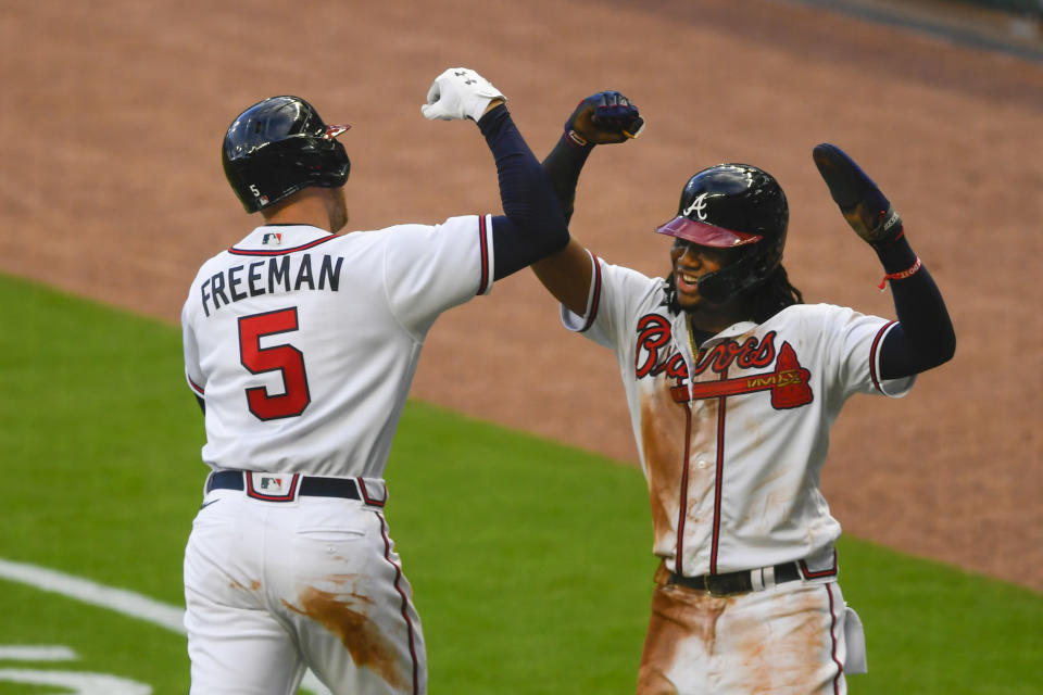 Atlanta Braves' Freddie Freeman (5) celebrates his two-run home run with Ronald Acua during the third inning of a baseball game against the Tampa Bay Rays, Wednesday, July 29, 2020 in Atlanta. (AP Photo/John Amis)