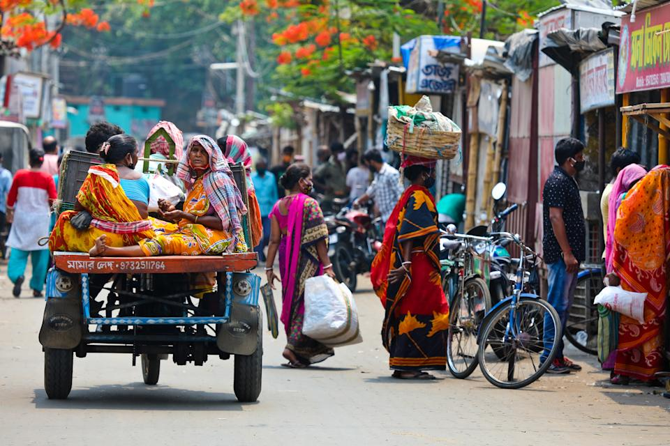May 1, 2021 - Katwa WB India : Taken this picture of men and women above in the busy marketplace. Many are wearing mask but many not. Also, social distancing maintained. Risk of infection is very high.