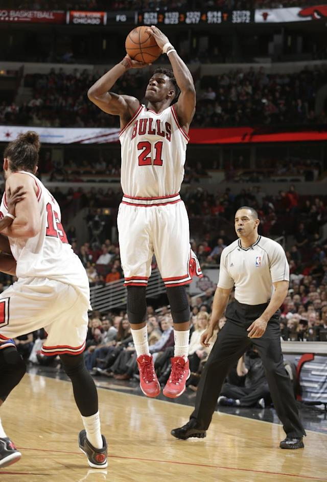 CHICAGO, IL - DECEMBER 18: Jimmy Butler #21 of the Chicago Bulls drives against the New York Knicks on December 18, 2014 at the United Center in Chicago, Illinois. (Photo by Jeff Haynes/NBAE via Getty Images)