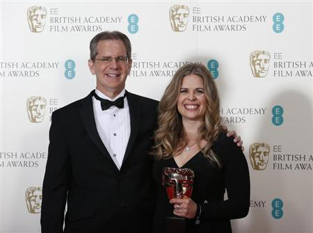 "Chris Buck and Jennifer Lee celebrate after winning the Animated Film category for ""Frozen"" at the BAFTA awards ceremony in London"