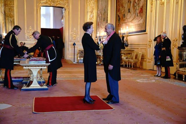 Bob Champion is made a CBE by the Princess Royal at Windsor Castle