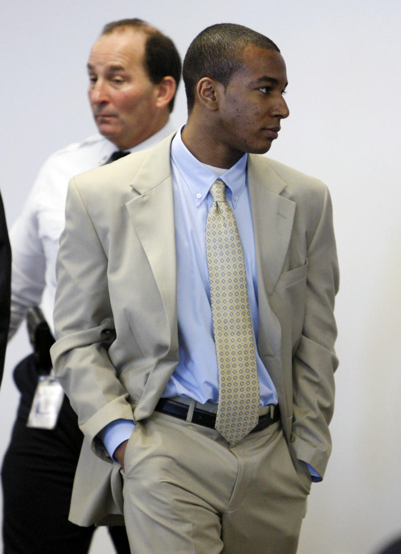 FILE - In this April 6, 2011 file photo, Jabrai Jordan Copney, right, of New York, stands during a recess in his trial at Middlesex Superior Court in Woburn, Mass. Copney was convicted Friday, April 22, 2011 of fatally shooting Justin Cosby, a drug dealer, during a robbery inside a Harvard University dormitory. (AP Photo/Bizuayehu Tesfaye, File)