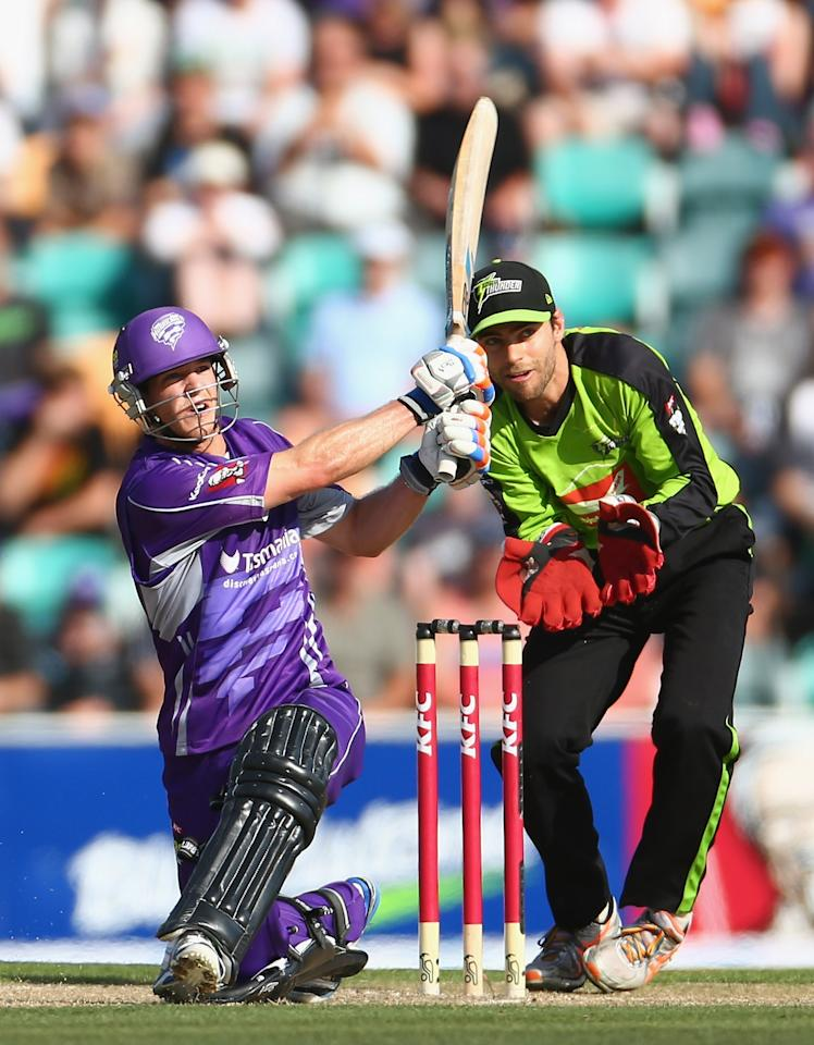 HOBART, AUSTRALIA - DECEMBER 23: Tim Paine of the Hurricanes hits out during the Big Bash League match between the Hobart Hurricanes and the Sydney Thunder at Blundstone Arena on December 23, 2012 in Hobart, Australia.  (Photo by Robert Cianflone/Getty Images)
