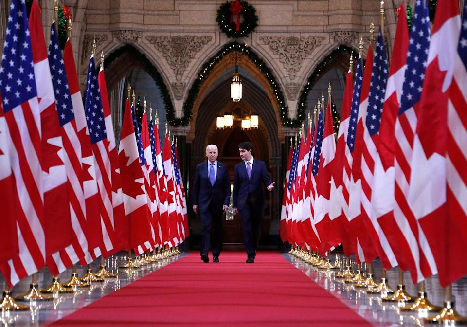File photo of Prime Minister Justin Trudeau and U.S. Vice-President Joe Biden walking down the Hall of Honour on Parliament Hill in Ottawa on Dec. 9, 2016. (Photo: CP/Patrick Doyle)