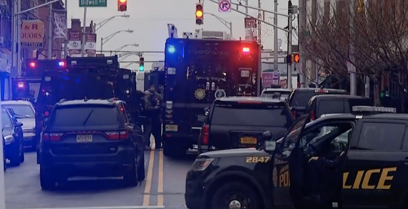 SWAT teams and officers surround the store in New Jersey. Source: USA Today