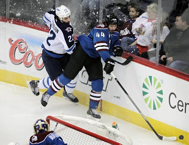Winnipeg Jets right wing Chris Thorburn (22) checks Colorado Avalanche defenseman Ryan Wilson (44) during the first period of an NHL hockey game in Denver on Sunday, Dec. 29, 2013. (AP Photo/Joe Mahoney)