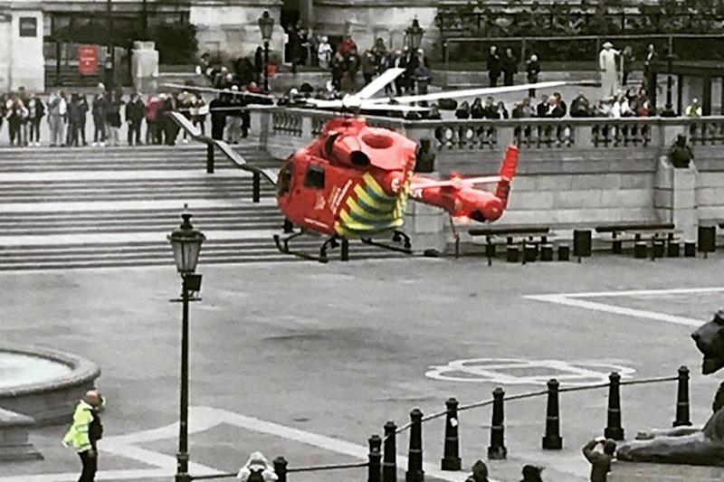 Emergency response: An air ambulance lands in Trafalgar Square following a crash (Twitter/Mike Young)