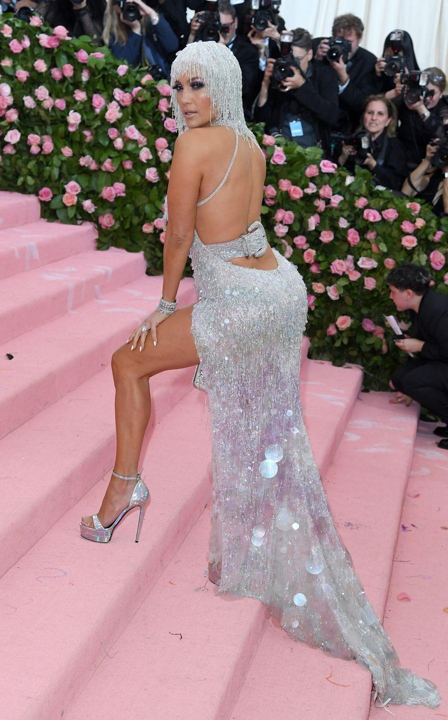"<p>She straight-up sparkles in this Versace gown at the<a href=""https://www.cosmopolitan.com/uk/fashion/celebrity/g27379305/met-gala-2019/"" rel=""nofollow noopener"" target=""_blank"" data-ylk=""slk:2019 Met Gala"" class=""link rapid-noclick-resp""> 2019 Met Gala</a>, accessorizing with a bejeweled headpiece and ALL the jewelry. I mean, I'm literally blinded in the best way possible.</p>"