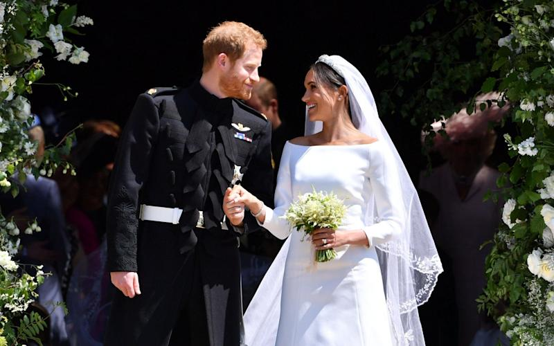 The Duke and Duchess of Sussex on their wedding day - AFP