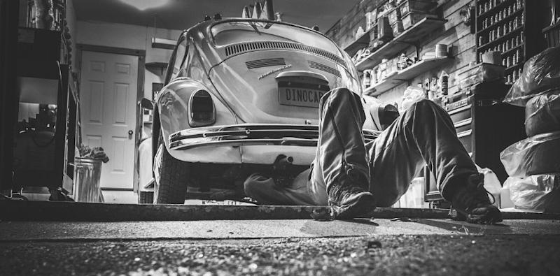 Mechanic working at a car