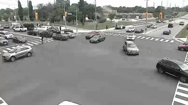 An image of the intersection of Martin Grove Road and Eglinton Avenue West where police say a driver injured a pedestrian by crashing into a bus shelter. (Toronto Police Service - image credit)