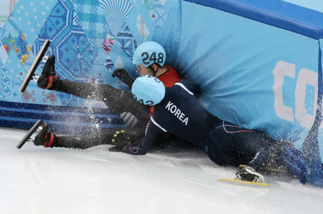 Sjinkie Knegt of Netherlands, back, and Park Se-Yeong of South Korea crash out in a men's 1500m short track speedskating final at the Iceberg Skating Palace during the 2014 Winter Olympics, Monday, Feb. 10, 2014, in Sochi, Russia. (AP Photo/Ivan Sekretarev)