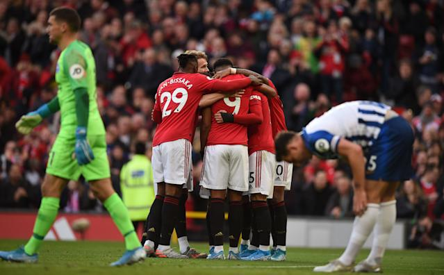United celebrate going in front through Andreas Pereira (Photo by OLI SCARFF/AFP via Getty Images)