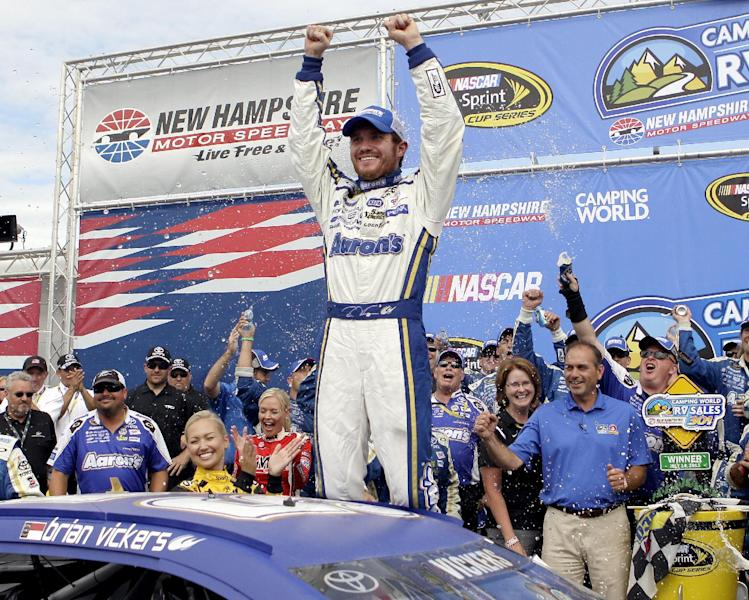 Brian Vickers celebrates in victory lane after winning the NASCAR Sprint Cup Series auto race, Sunday, July 14, 2013, at New Hampshire Motor Speedway in Loudon, N.H. (AP Photo/Mary Schwalm)