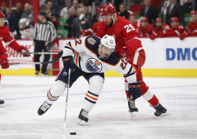 Edmonton Oilers right wing Tobias Rieder (22) controls the puck as Detroit Red Wings defenseman Mike Green (25) defends during the first period of an NHL hockey game, Saturday, Nov. 3, 2018, in Detroit. (AP Photo/Carlos Osorio)