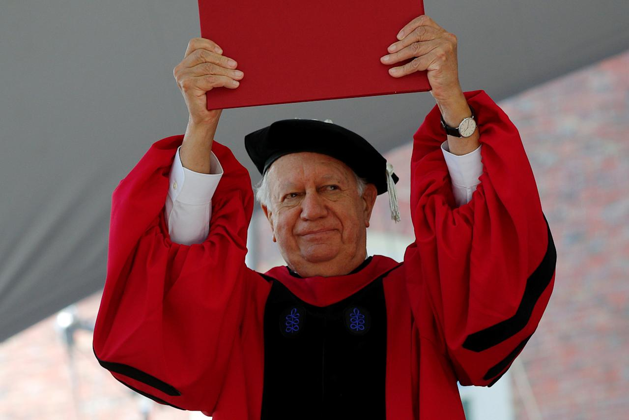 Former President of Chile Ricardo Lagos holds up his honorary Doctor of Laws degree during the 367th Commencement Exercises at Harvard University in Cambridge, Massachusetts, U.S., May 24, 2018.   REUTERS/Brian Snyder