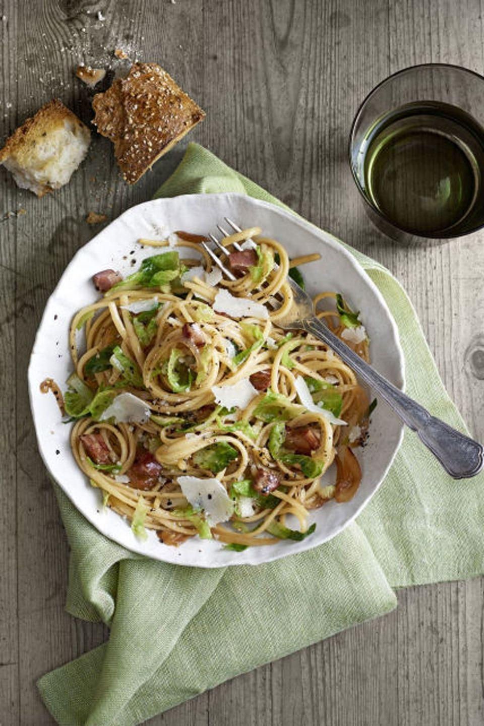 """<p>Crispy pancetta and caramelized onions give this simple dish plenty of flavor.</p><p><strong><a href=""""https://www.countryliving.com/food-drinks/recipes/a6337/pancetta-brussels-sprouts-linguini-recipe-clx0215/"""" rel=""""nofollow noopener"""" target=""""_blank"""" data-ylk=""""slk:Get the recipe"""" class=""""link rapid-noclick-resp"""">Get the recipe</a>.</strong></p>"""
