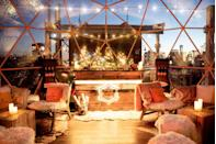 """<p>What could be more elegant that sipping Veuve Clicquot in an exclusive ski lodge? Taking in the Manhattan skyline as you do it. That's exactly the experience that the famed champagne house and Lower East Side staple <a href=""""https://www.mrpurplenyc.com/"""" rel=""""nofollow noopener"""" target=""""_blank"""" data-ylk=""""slk:Mr. Purple"""" class=""""link rapid-noclick-resp"""">Mr. Purple</a> are aiming for with their winter collaboration, which transforms Mr. Purple into a festive après ski themed experience. Purple deer heads and digital fireplaces deck out the main area, while the terrace gains a Veuve Clicquot ski lodge-themed seating bubble and a champagne bar. </p><p><em>Hotel Indigo Lower East Side, 180 Orchard Street</em>.</p>"""
