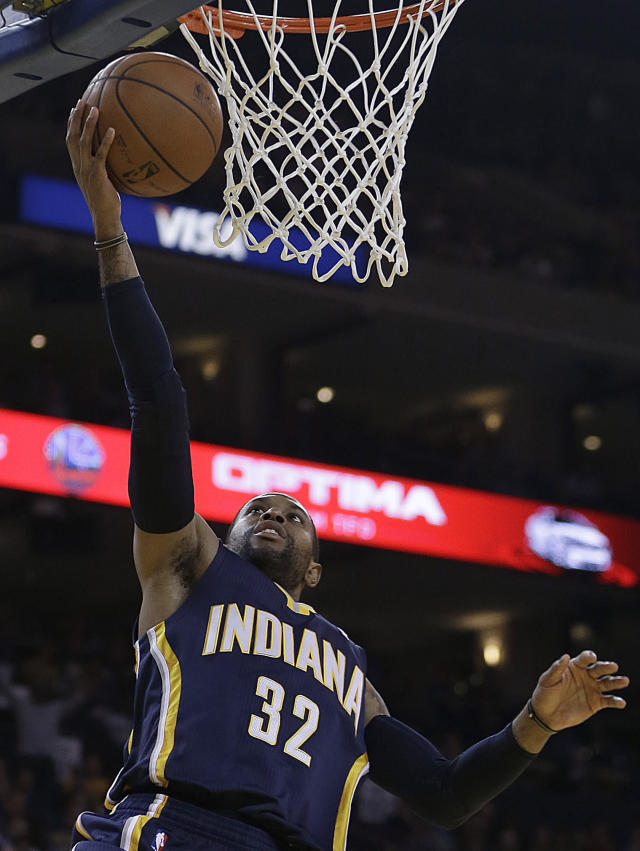 Indiana Pacers' C.J. Watson lays up a shot against the Golden State Warriors during the first half of an NBA basketball game, Monday, Jan. 20, 2014, in Oakland, Calif. (AP Photo/Ben Margot)