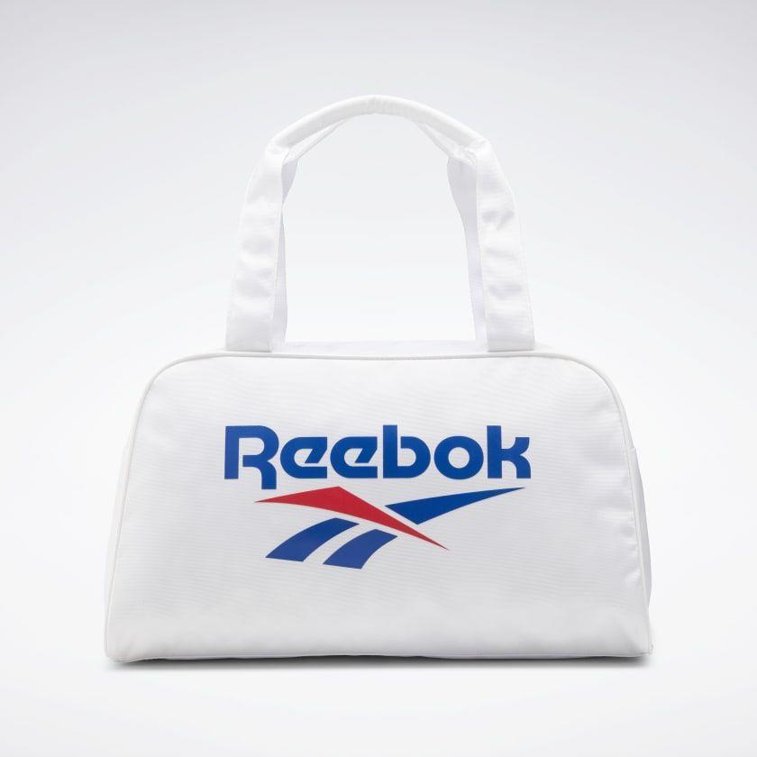"""<p><strong>reebok</strong></p><p>reebok.com</p><p><strong>$29.97</strong></p><p><a href=""""https://go.redirectingat.com?id=74968X1596630&url=https%3A%2F%2Fwww.reebok.com%2Fus%2Fclassics-foundation-duffel-bag%2FGG6716.html&sref=https%3A%2F%2Fwww.cosmopolitan.com%2Fstyle-beauty%2Ffashion%2Fg35696965%2Freebok-activewear-sale-hauliday%2F"""" rel=""""nofollow noopener"""" target=""""_blank"""" data-ylk=""""slk:Shop Now"""" class=""""link rapid-noclick-resp"""">Shop Now</a></p><p>We love a good throwback moment, and this logo-bearing bag is a great way to tap into that retro sporty trend that's happening RN.</p>"""