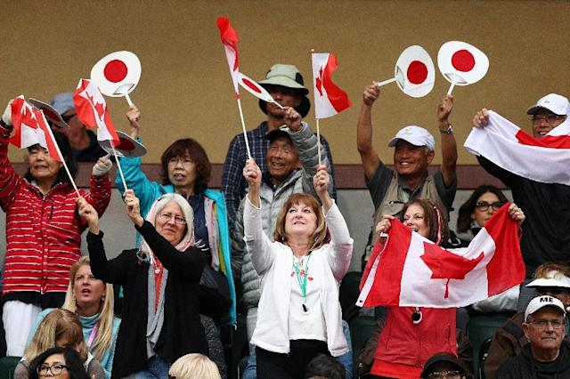 Japanese and Canadian fans cheer Yoshihito Nishioka and Felix Auger-Aliassime in Nishioka's rollercoaster win over the Canadian in the third round of the ATP Indian Wells Masters (AFP Photo/Yong Teck Lim)