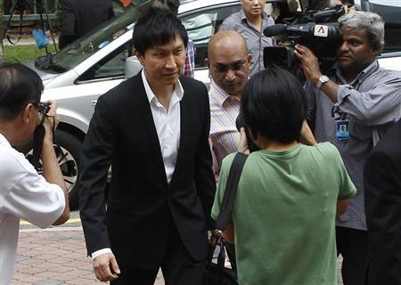 City Harvest Church founder Kong Hee arrives for his trial at the Subordinate Courts in Singapore May 15, 2013. REUTERS/Edgar Su/Files
