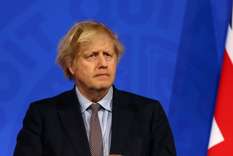 FILE PHOTO: Britain's PM Johnson holds a news conference on the COVID-19 pandemic, in London