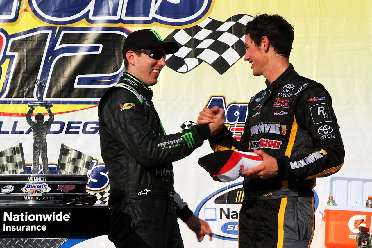 TALLADEGA, AL - MAY 05:  Kyle Busch (L), driver of the #54 Monster Energy Toyota, congratulates Joey Logano, driver of the #18 GameStop Toyota, in Victory Lane after Logano won the NASCAR Nationwide Series Aaron's 312 at Talladega Superspeedway on May 5, 2012 in Talladega, Alabama.  (Photo by Jerry Markland/Getty Images for NASCAR)