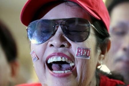 A supporter of Pheu Thai Party reacts after unofficial results, during the general election in Bangkok, Thailand, March 24, 2019. REUTERS/Athit Perawongmetha