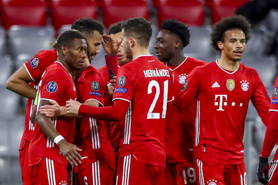 Bayern's Eric Maxim Choupo-Moting celebrates with his teammates scoring his side's second goal during the Champions League, round of 16, second leg soccer match between FC Bayern Munich and Lazio at the soccer Arena stadium in Munich, Germany, Wednesday, March 17, 2021. (AP Photo/Matthias Schrader)