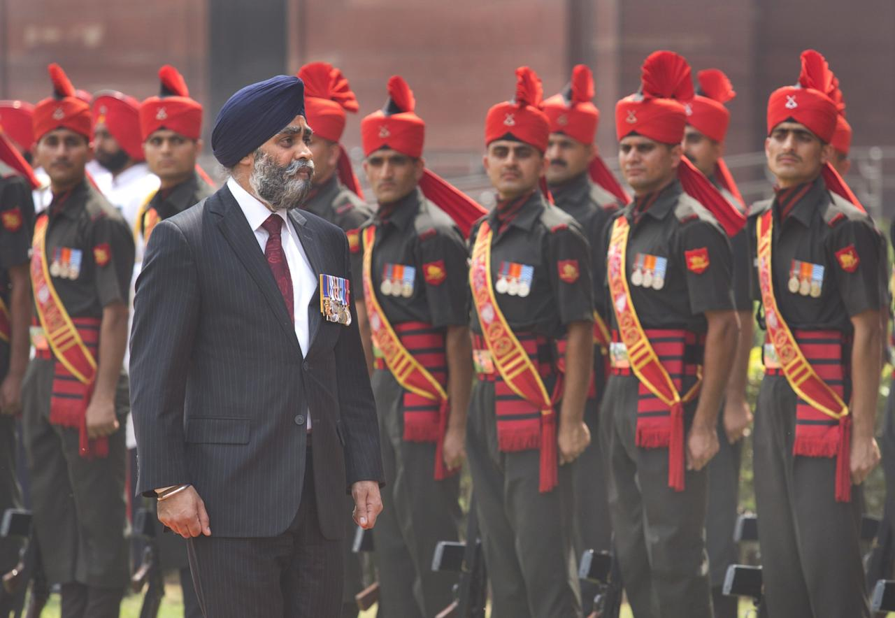 <p>Canadian Defence Minister Harjit Sajjan inspects a tri-services guard of honour upon his arrival at the Indian Defence ministry in New Delhi, India, Tuesday, April 18, 2017. Singh is in India on a seven-day visit. (AP Photo/Manish Swarup) </p>