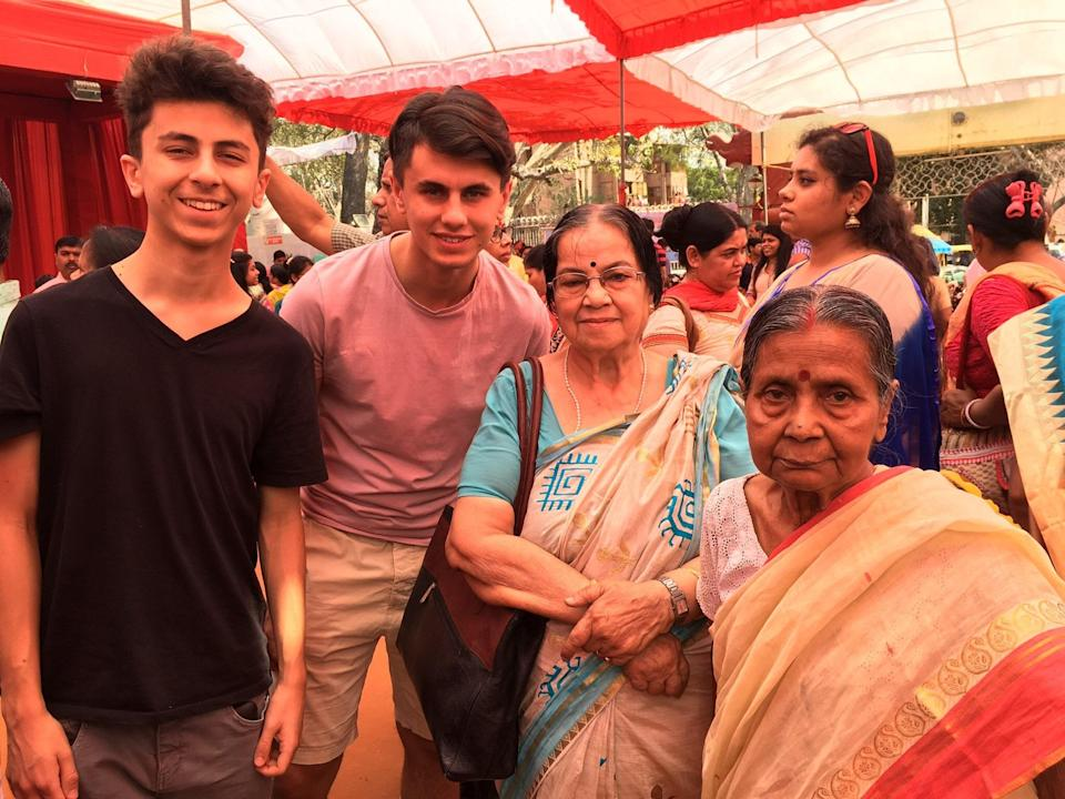Namita Sinha, 82, (right) with her best friend and two grandsons in pre-Covid times