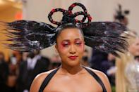 """<p>Naomi Osaka was not joking around when it came to her monochromatic look at the 2021 Met Gala. The tennis star celebrated American fashion with an over-the-top red and rosy eye with a matching lip, crafted by makeup artist <a href=""""https://www.instagram.com/jessicasmalls/"""" rel=""""nofollow noopener"""" target=""""_blank"""" data-ylk=""""slk:Jessica Smalls"""" class=""""link rapid-noclick-resp"""">Jessica Smalls</a> using Charlotte Tilbury products. For hair, Osaka took things to the next level with a bowtie-inspired braided updo created by <a href=""""https://www.instagram.com/themartyharper/"""" rel=""""nofollow noopener"""" target=""""_blank"""" data-ylk=""""slk:Marty Harper"""" class=""""link rapid-noclick-resp"""">Marty Harper</a> using <a href=""""https://ulta.ztk5.net/c/249354/164999/3037?subId1=ISWereStillNotOvertheBestBeautyLooksFromthe2021MetGalakgreavesMetGal4544674202109I&u=https%3A%2F%2Fwww.ulta.com%2Fp%2Fperfect-smooth-hair-oil-pimprod2013657"""" rel=""""sponsored noopener"""" target=""""_blank"""" data-ylk=""""slk:NatureLab. Tokyo Perfect Smooth Hair Oil"""" class=""""link rapid-noclick-resp"""">NatureLab. Tokyo Perfect Smooth Hair Oil</a> for extra shine. He finished off by adorning the 'do with red jewels. </p>"""